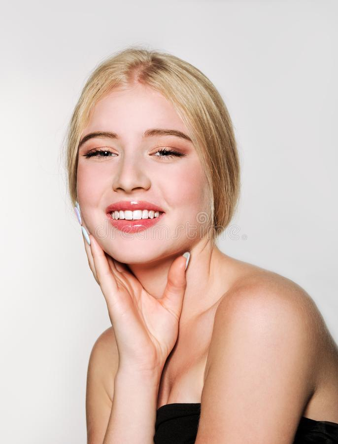 Portrait of beautiful blonde young woman face.  Spa model girl with fresh clean skin isolated on a white background stock photo