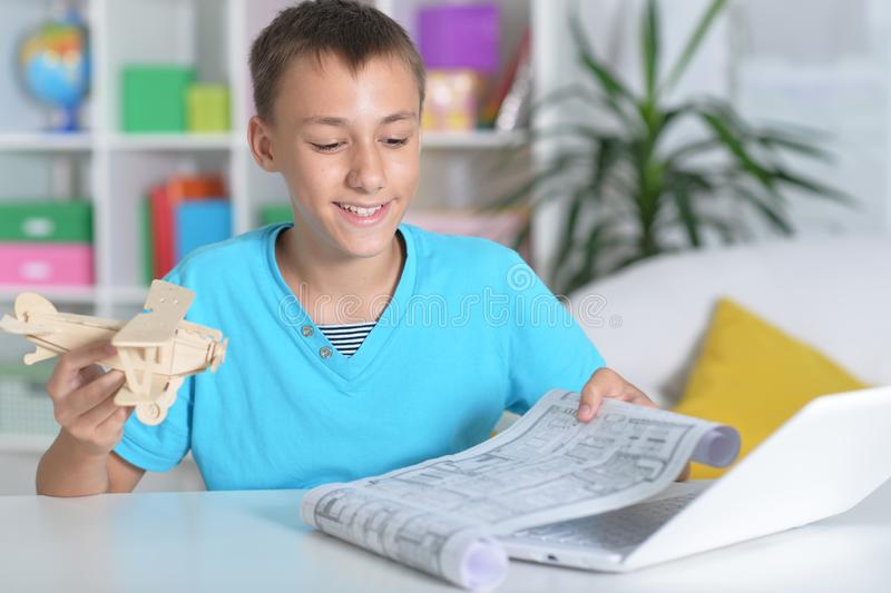 Portrait of beautiful boy using modern laptop at home royalty free stock photography