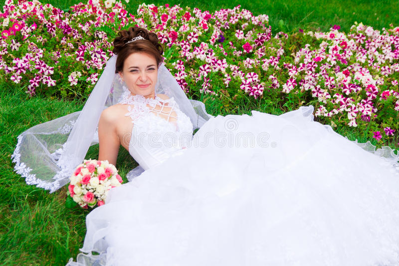 Portrait of a beautiful bride. On the grass stock photography