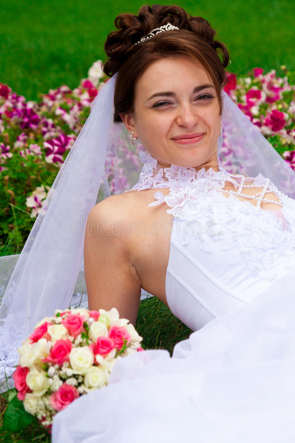 Portrait of a beautiful bride. On the grass stock photo