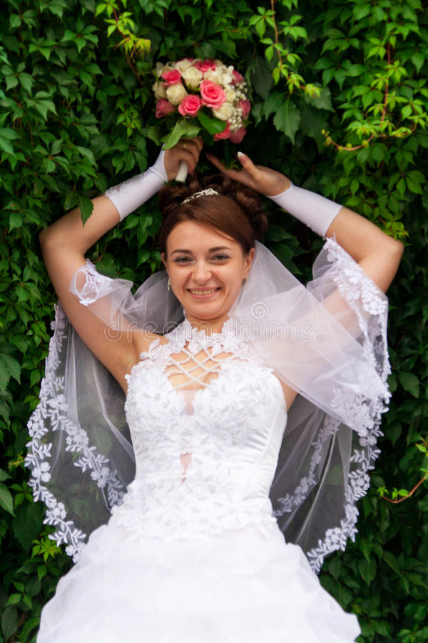 Portrait of a beautiful bride. At green wall royalty free stock images