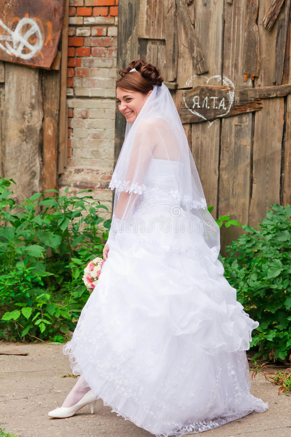 Portrait of a beautiful bride. At wooden wall royalty free stock photography