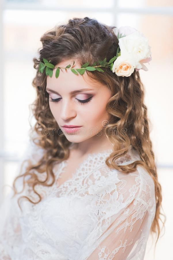 Portrait of a beautiful bride in her hair flower stock images