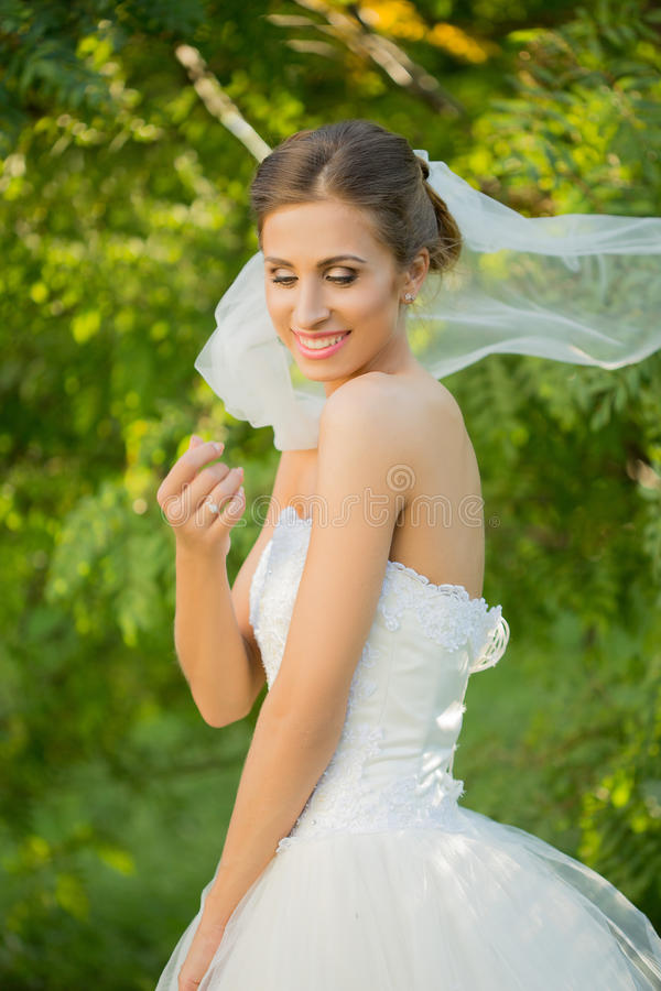 Portrait of a beautiful bride in the park royalty free stock photography