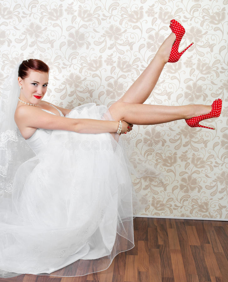 Portrait of beautiful bride in red shoes stock images