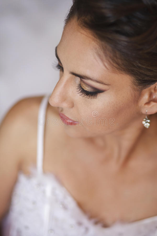 Portrait of beautiful bride in wedding dress. Portrait of beautiful bride sitting in a wedding dress royalty free stock photography