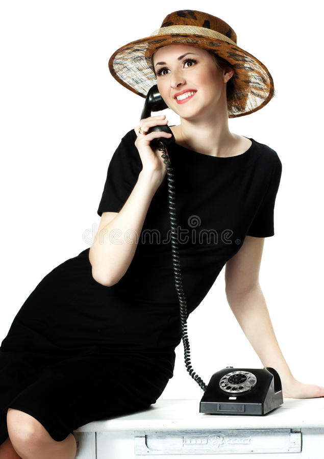 Portrait of a beautiful brown-eyed woman in a hat with a vintage royalty free stock image