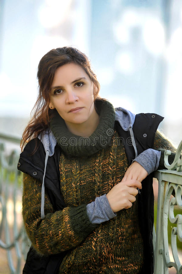 Portrait of a beautiful brown-eyed young woman royalty free stock photo