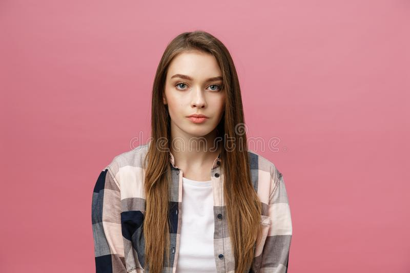 Portrait of beautiful brunette caucasian woman in pink studio royalty free stock photos