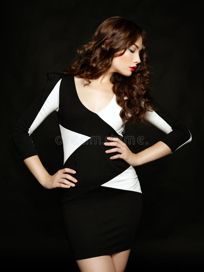 Portrait of beautiful brunette woman in black dress royalty free stock images