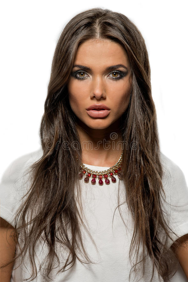 Portrait of beautiful brunette woman with lips and long hair. Close-up portrait of beautiful brunette woman with lips and long hair royalty free stock photo