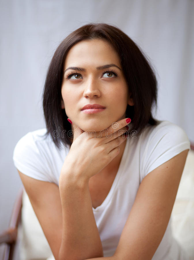 Portrait of beautiful brunette young woman stock photography