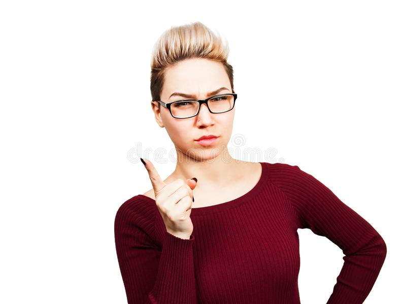 Portrait of beautiful business woman in glasses showing finger up. Isolated on white background stock photography