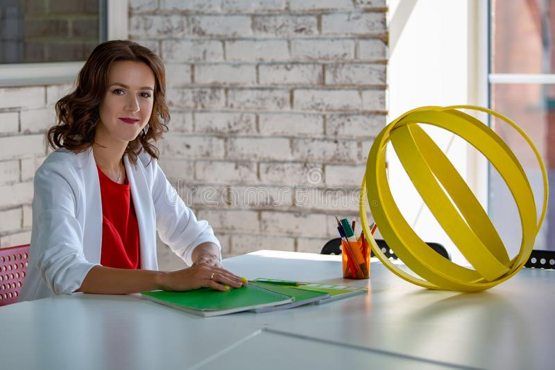 Portrait of a beautiful business woman in the workplace stock photography