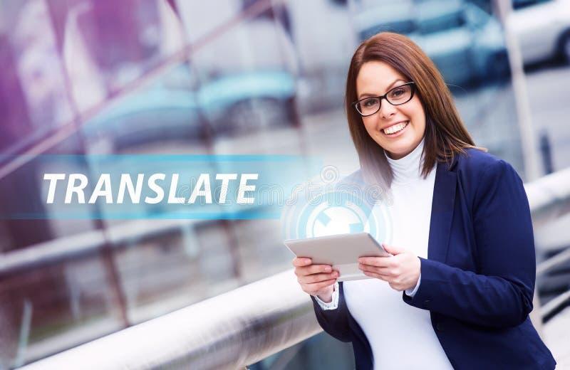 Translate. Portrait of beautiful businesswoman using technology tablet for working via futuristic screen hologram. Translate stock photo