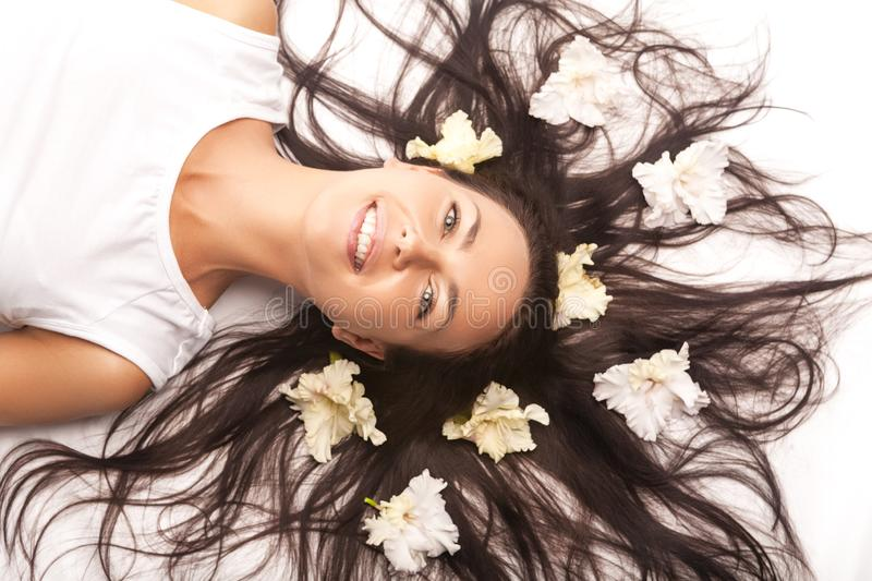 Portrait of Beautiful Caucasian Brunette Woman Laying on Floor With Hair Outspread royalty free stock photography