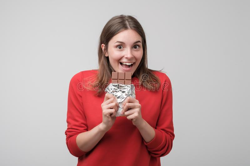 Portrait of the beautiful caucasian girl eating chocolate royalty free stock image