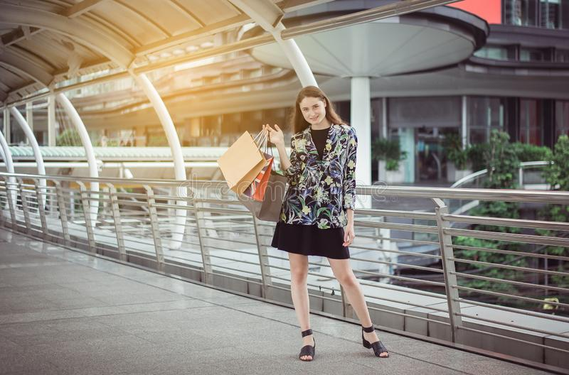 Portrait of beautiful caucasian woman smling and holding shopping bags in city,Lifestyle concept royalty free stock image