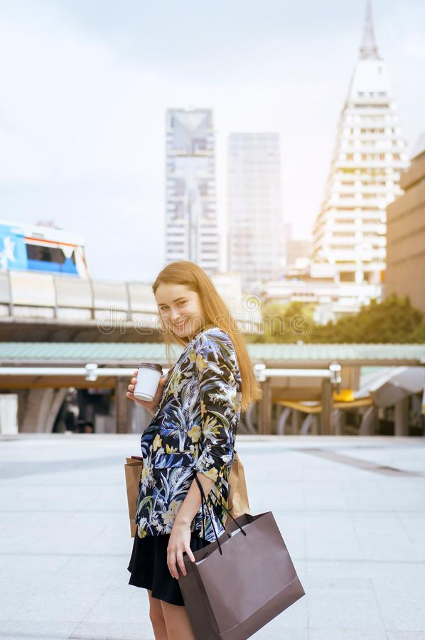 Portrait of beautiful caucasian women smling and holding shopping bags in city,Lifestyle concept stock images