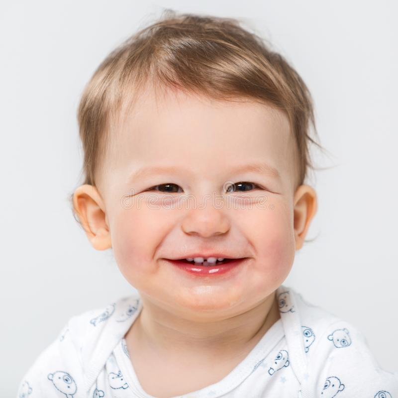 Portrait of a beautiful cheerful little boy. Child`s face closeup stock images