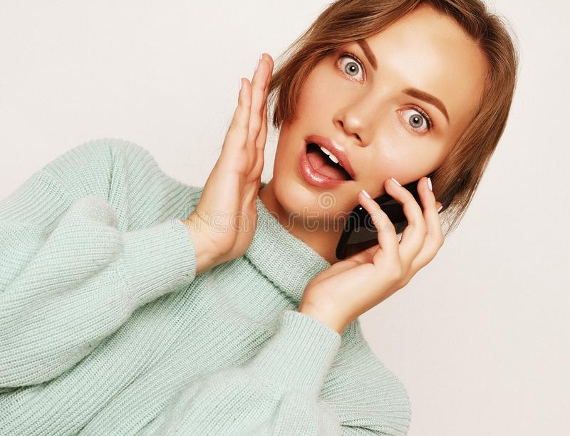 beautiful cheerful woman talking on mobile phone royalty free stock image