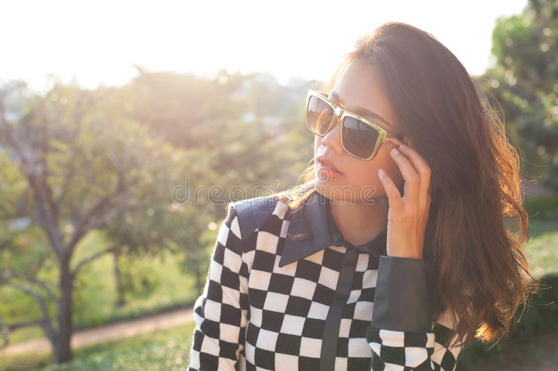 Portrait of beautiful chick fashion woman wearing sun glasses ag royalty free stock image