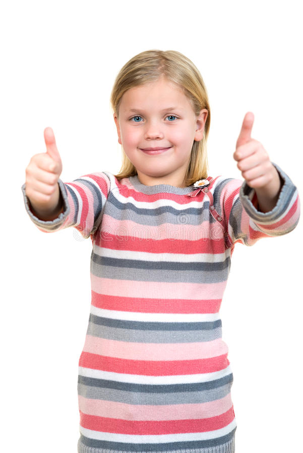 Portrait of a beautiful and confident girl showing thumbs up isolated one white.  stock photo