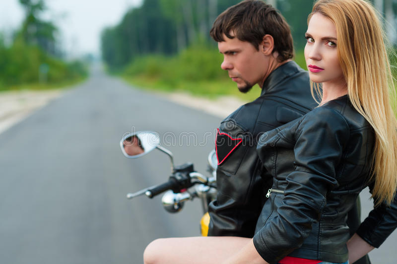 Portrait beautiful couple motorcyclists stock images