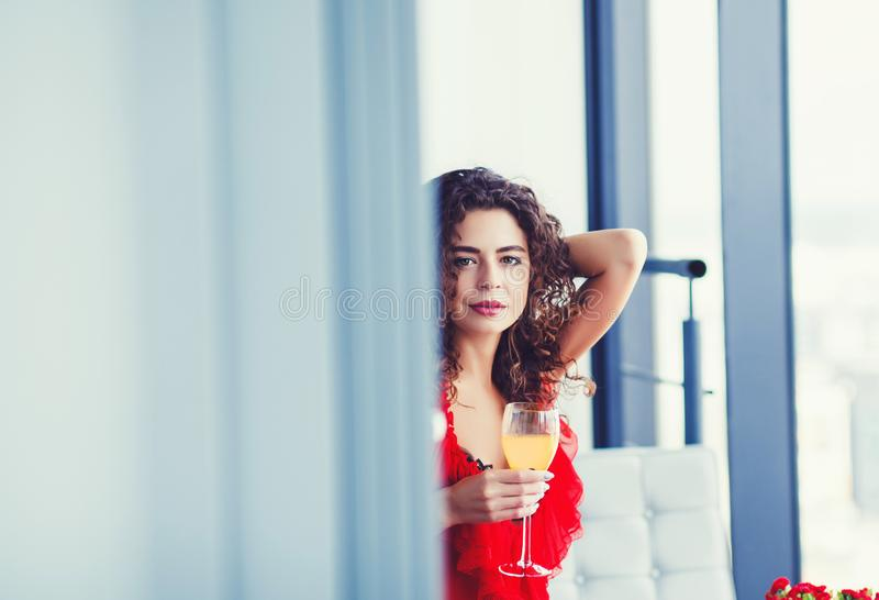 Curly woman tasting wine stock images
