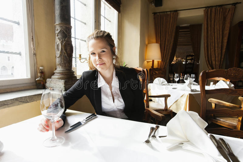Portrait of beautiful customer with wine glass at restaurant table royalty free stock photo