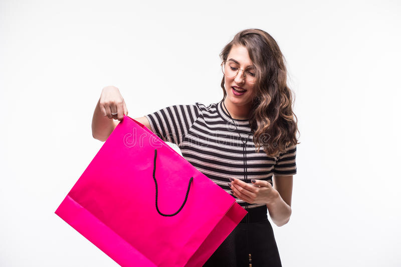 Portrait of beautiful cute happy sweet surprised woman girl holding in her hands big shopping bag isolated on white stock photo