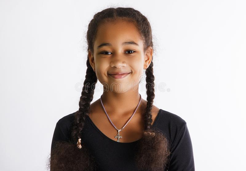 Portrait of beautiful dark-skinned girls on a white background. the child smiles. stock images
