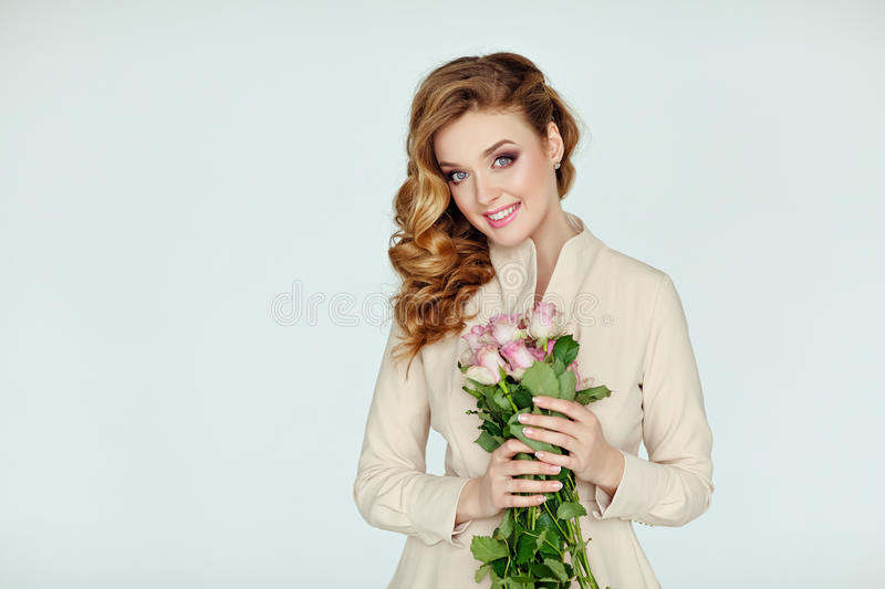 Portrait of a beautiful delicate blonde smiling girl with pink r royalty free stock photos