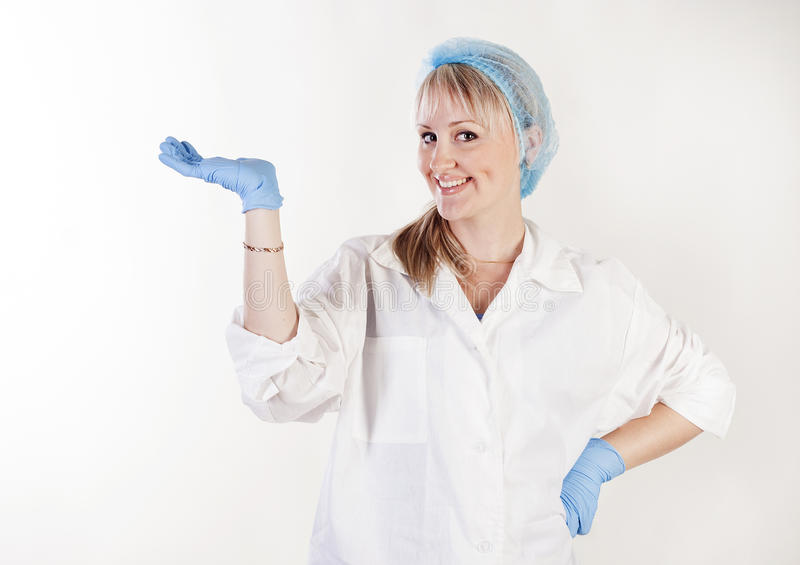 Portrait of beautiful doctor holding something in hand stock image