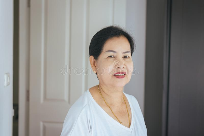 Portrait beautiful elderly asian woman in room,Senior female happy and smiling,Lifestyle concept,Positive thinking stock photo