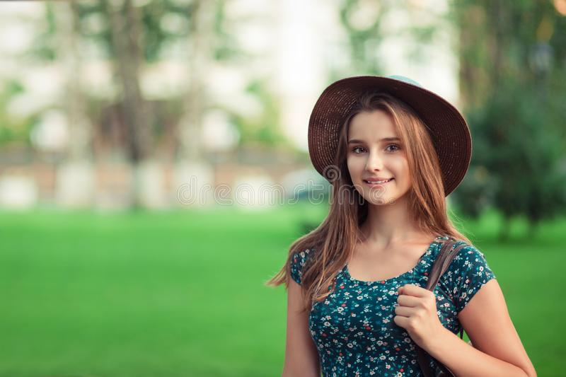 Portrait of a beautiful elegant woman in hat royalty free stock photography