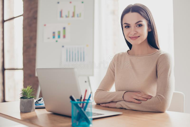 Portrait of beautiful experienced clever responsible charming po. Lite trendy wealthy rich authoritative boss chief financier economist sitting at the table in royalty free stock photography