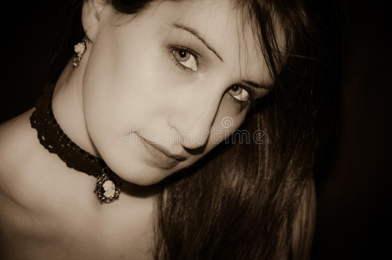 Beautiful face of european woman. Portrait of beautiful face of european gothic woman stock photo