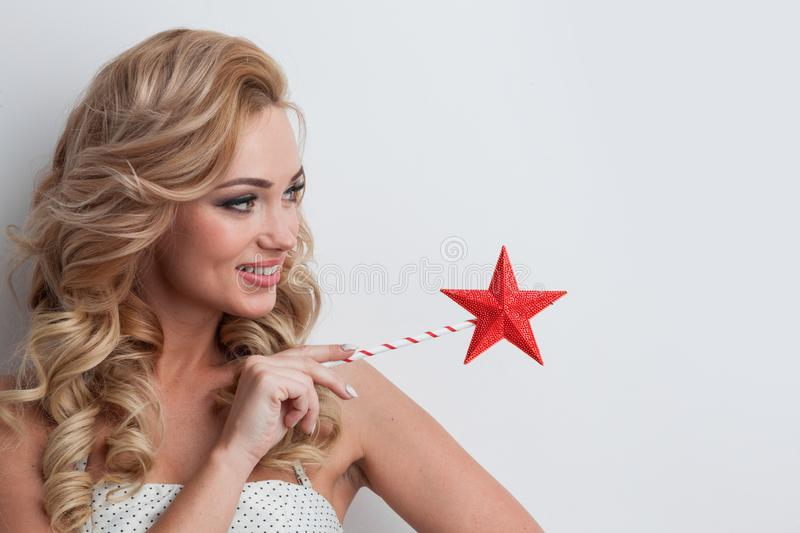 Fairy woman with star shaped magic wand royalty free stock image