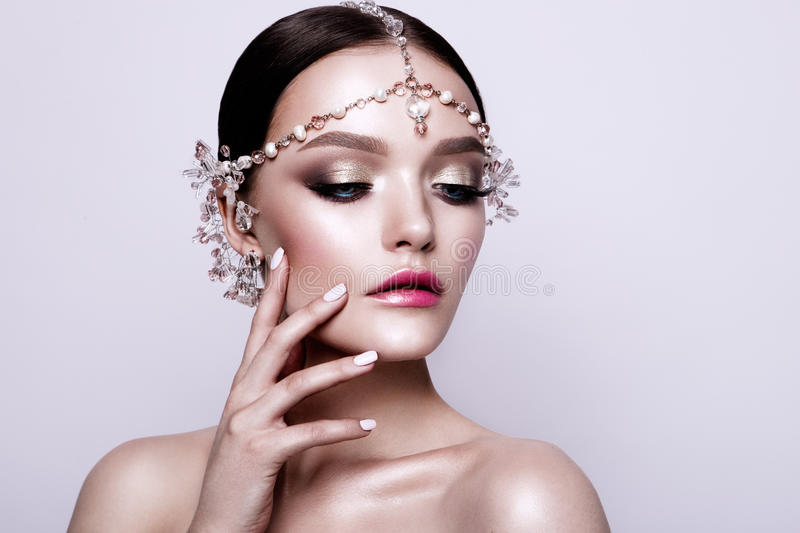 Portrait of a beautiful fashion brunette bride, sweet and sensual. Wedding make up and hair. Blue eyes. stock photography