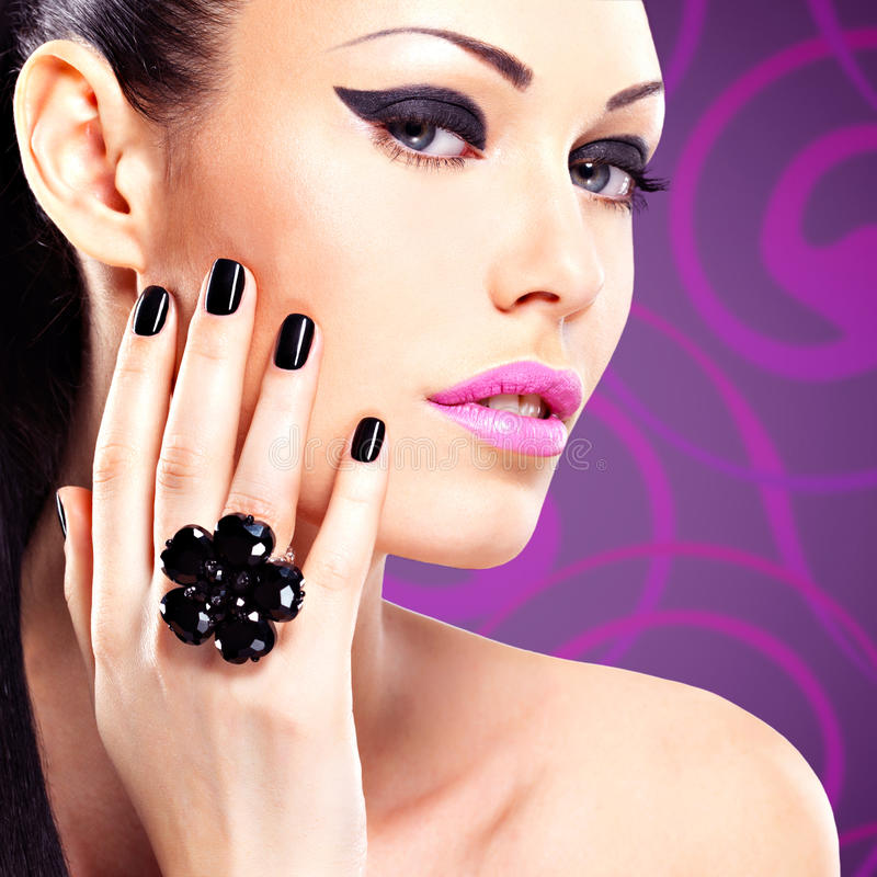 Portrait of a beautiful fashion woman with bright makeup. royalty free stock photography