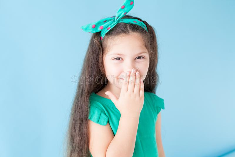 Portrait of beautiful fashionable little girl posing royalty free stock photography
