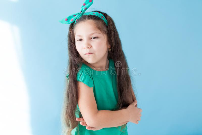Portrait of beautiful fashionable little girl posing stock photo