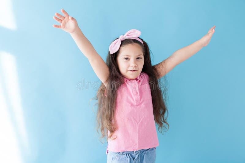 Portrait of beautiful fashionable little girl posing royalty free stock photo
