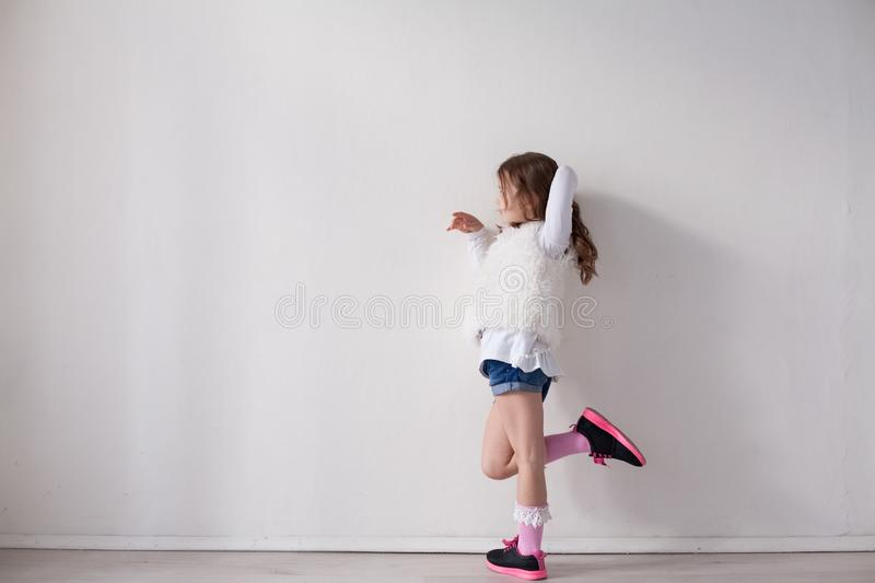 Portrait of beautiful fashionable little girl posing stock images