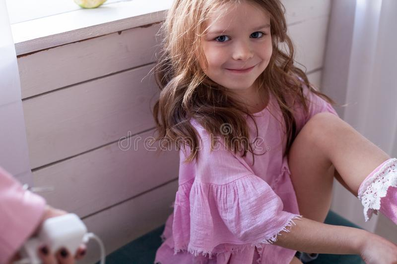 Portrait of beautiful fashionable little girl posing royalty free stock photos