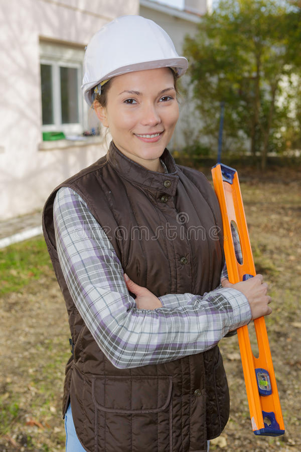 Portrait beautiful female architect at construction site royalty free stock photo