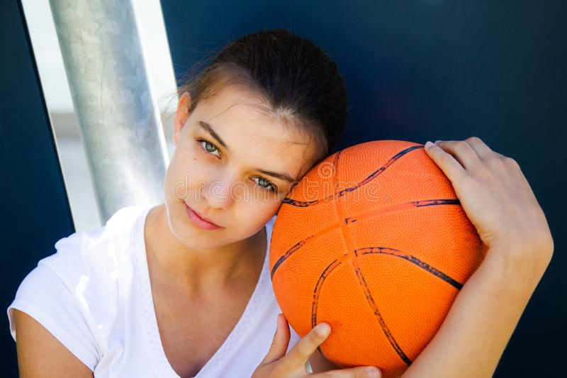 Portrait of a beautiful female basketball player stock images