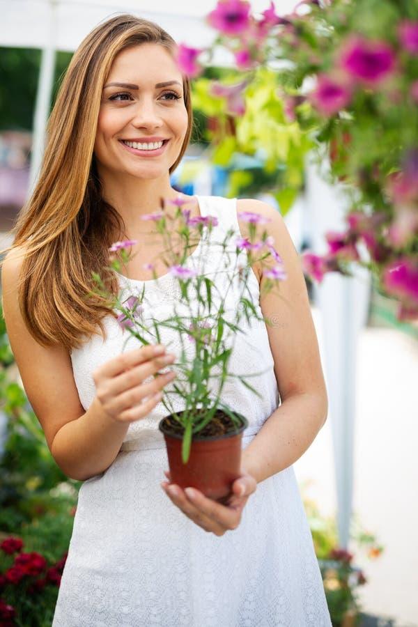 Portrait of beautiful female customer shopping flower, smiling royalty free stock photo