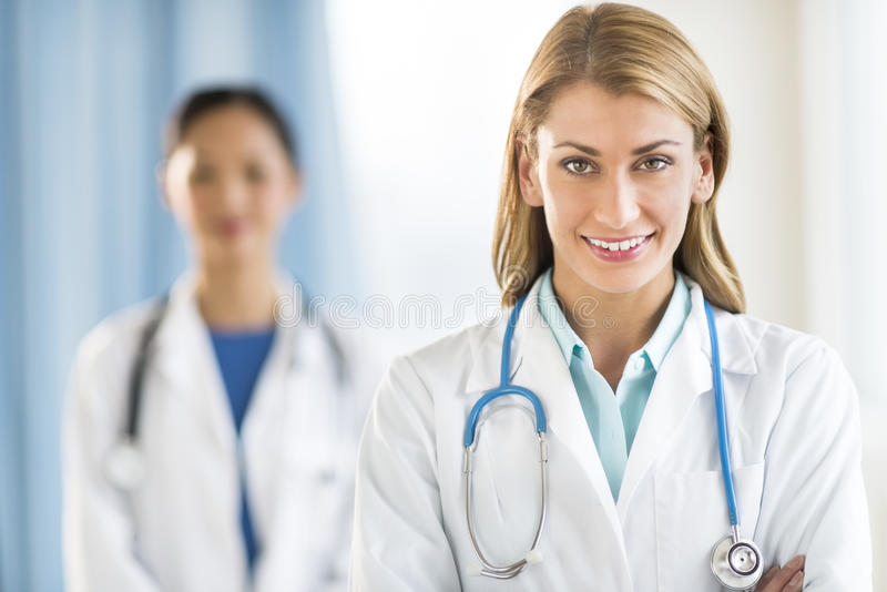 Portrait Of Beautiful Female Doctor Smiling In Clinic stock photography
